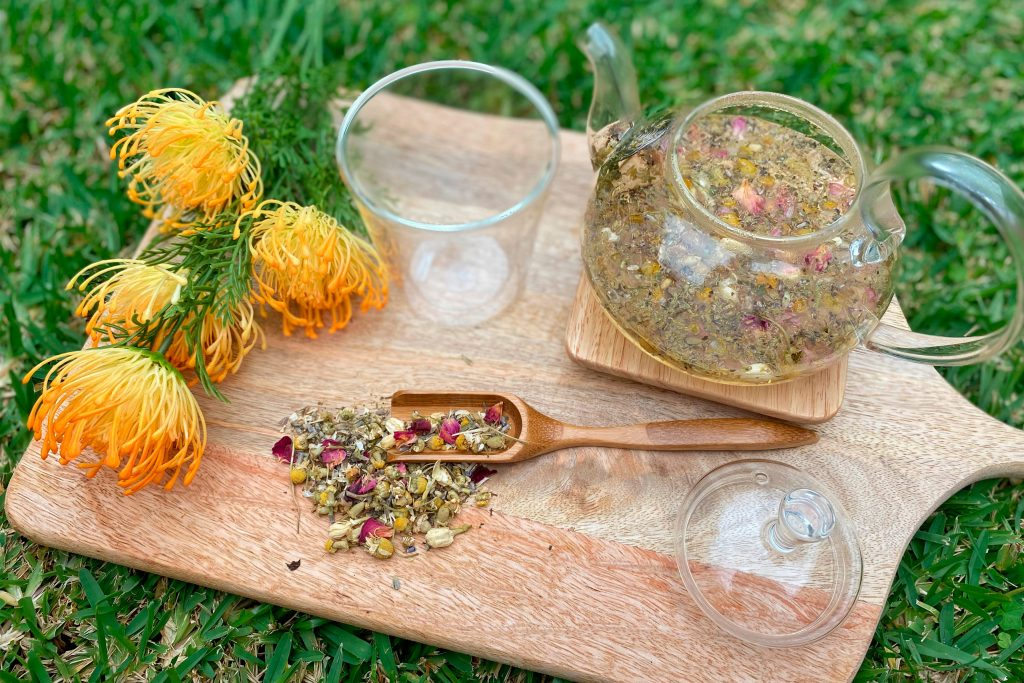 herbal tea served on timber board on grass