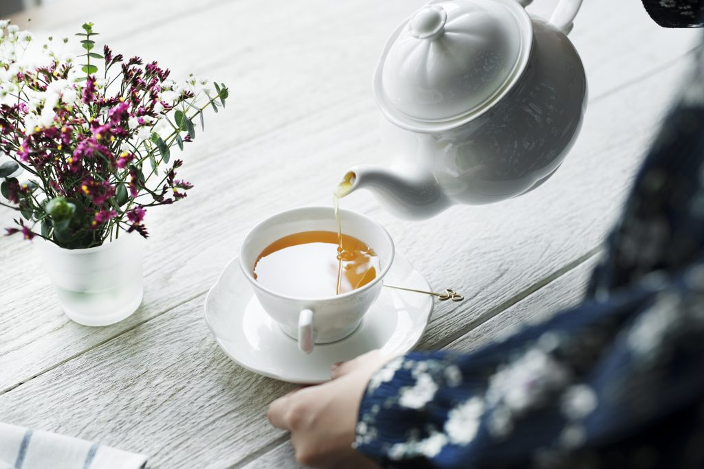 Pouring cup of tea